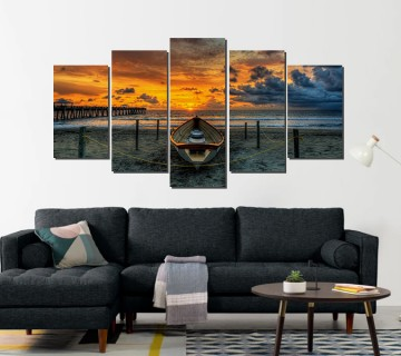 Sun set over the ocean beach image reprinted on canvas